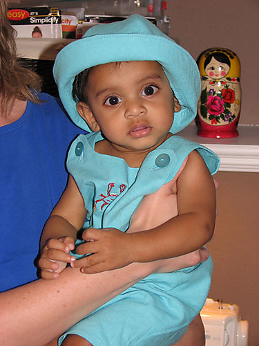 Ibrihim in his new blue suit and hat