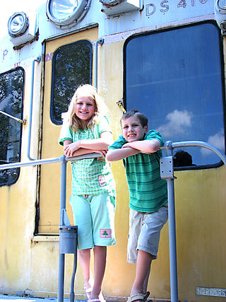 B & J on the back of the yellow train