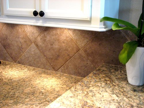 Granite and porcelain tile backsplash